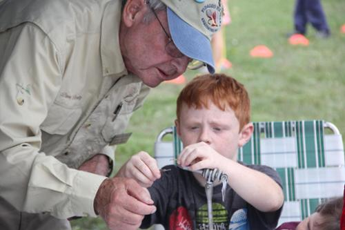 Learning to tie a fly at the Skagit River Salmon Festival.